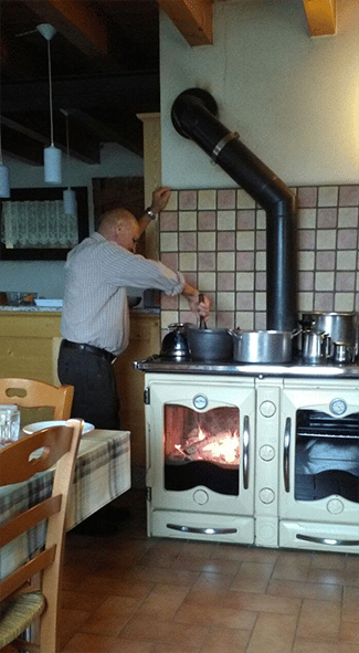 Grandpa Adeodato and the cooking of polenta taragna on a fire stove - Winter 2016 - ICAP Services